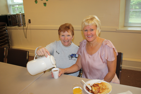 Cheryl-Gallant,-MP-being-served-breakfast-by-White-Lake-Women's-Institute-member-Wendy-Jonkman,-at-their-breakfast-fundraiser-during-the-annual-White-Lake-Community-Garage-Sale-3