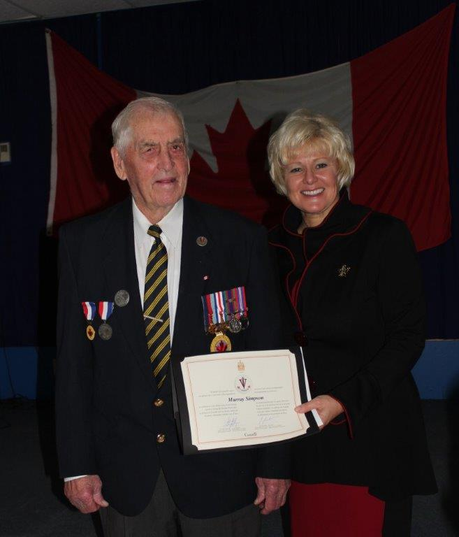 MP Gallant Presents Murray Simpson with WWII Veteran Pin