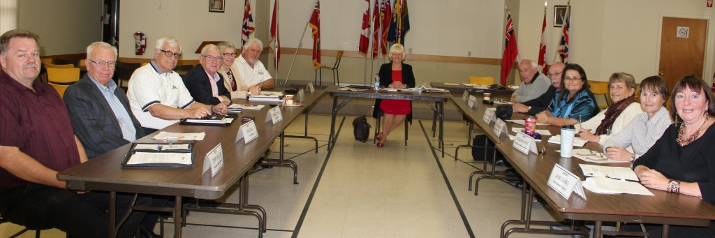 Pictured: Left side, from front: Reeve Terry Millar, Whitewater Region Township; Mayor Don Eady, Town of Renfrew; Mayor Michael Lemay, City of Pembroke; Mayor Bob Sweet, Town of Petawawa; Mayor Kim Love, Madawaska Valley Township; Mayor Hal Johnson, Whitewater Region Township  Right Side, from Front: Mayor Jane Dumas, Township of South Algonquin; Mayor Deborah Farr, Township of North Algona Wilberforce; Mayor Glenda McKay, Township of Greater Madawaska; Mayor Janice Visneskie-Moore, Township of Killaloe, Hagarty & Richards; Mayor Bob Kingsbury, Horton Township; Mayor Tom Peckett, Township of McNab-Braeside
